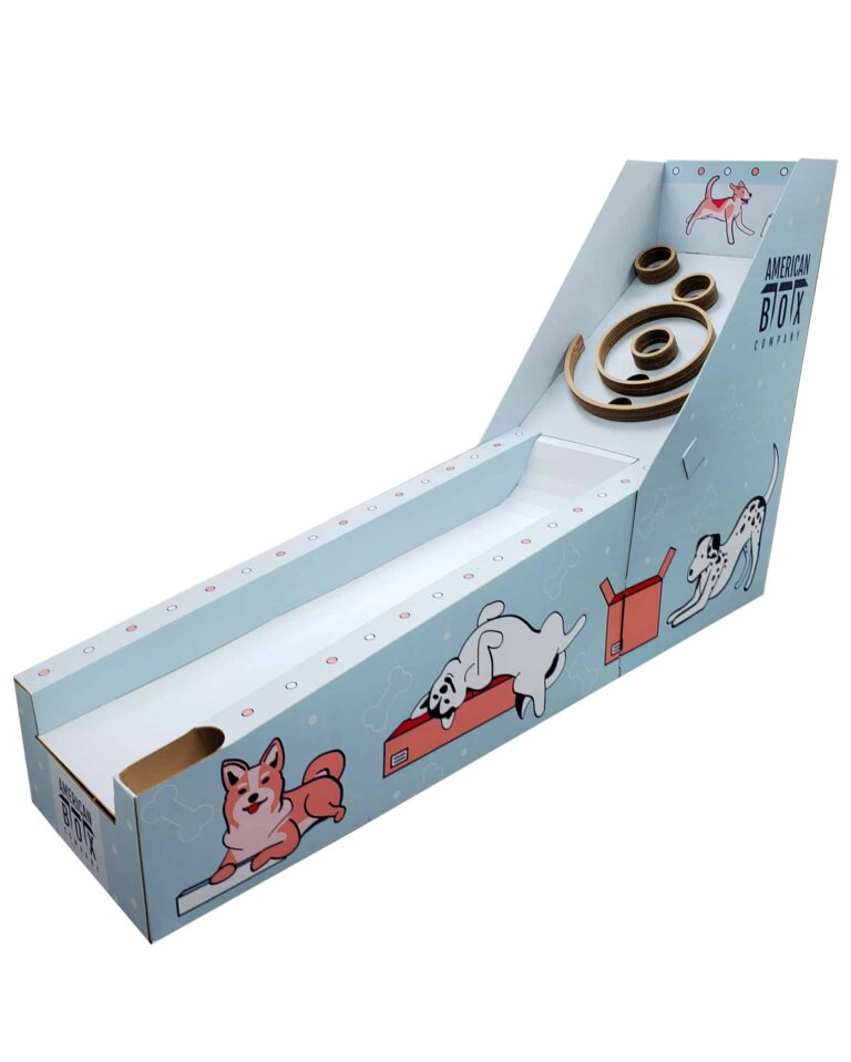 skeeball machine made out of corrugated with illustrations of dogs on the sides