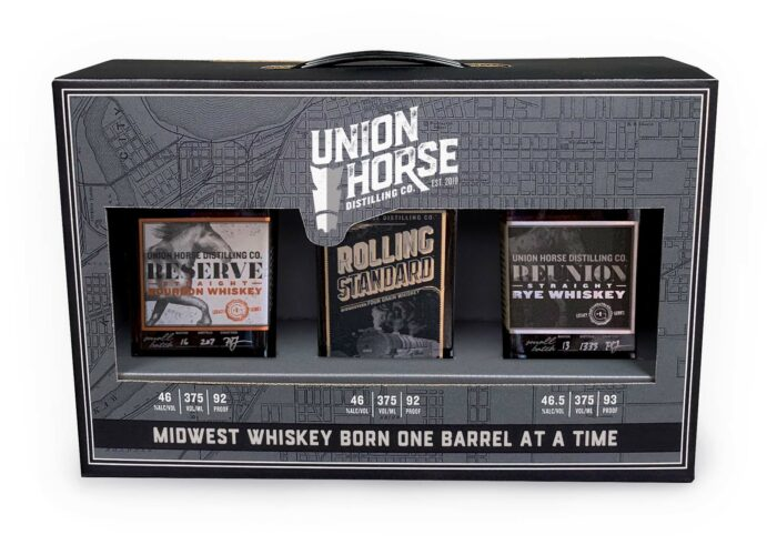 retail display packaging with three bottles of whiskey and a handle