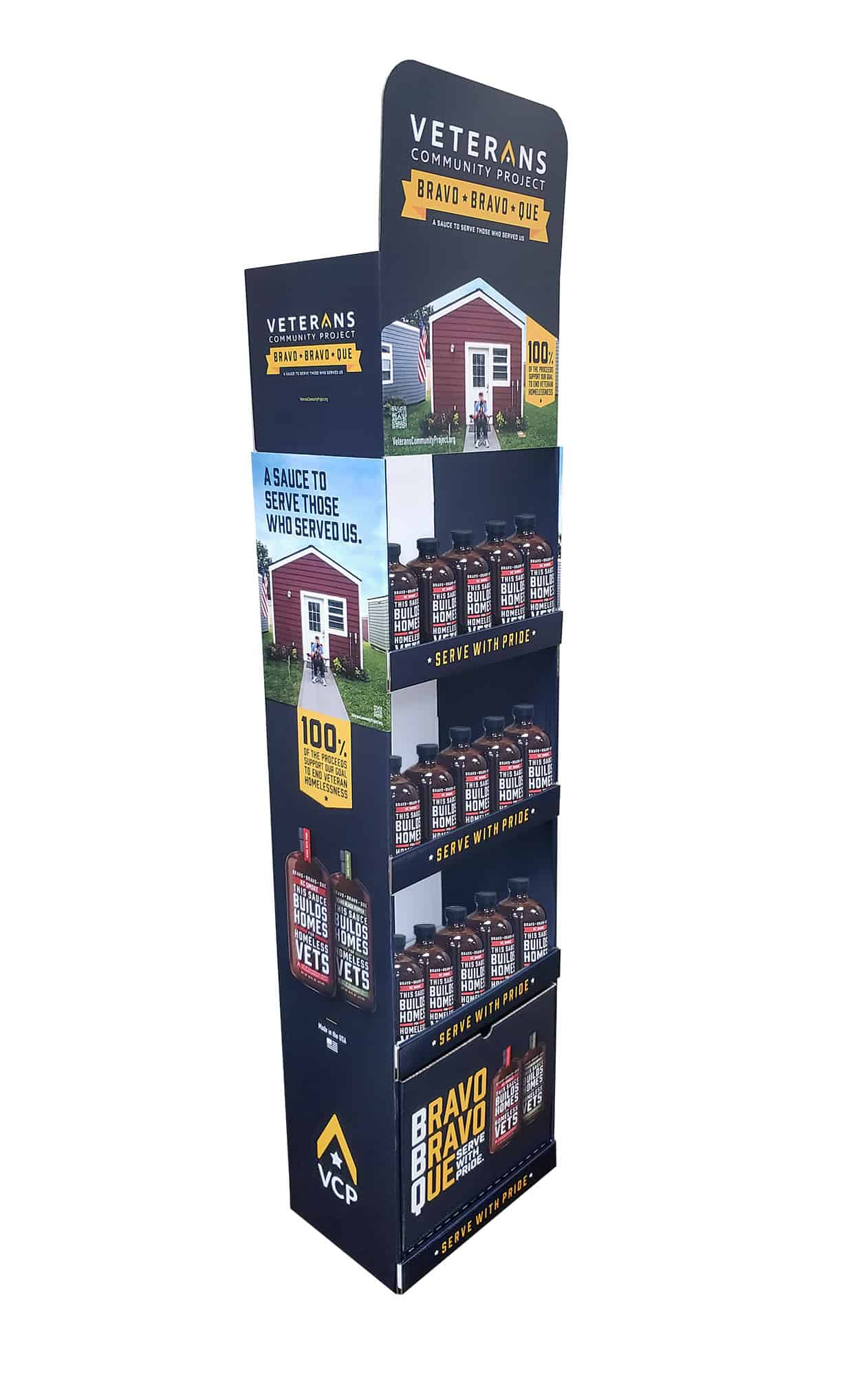 A tall floorstand BBQ POP display with text 'Veterans Community Project Bravo Bravo Que'