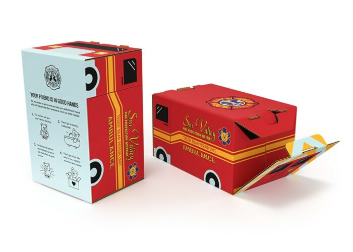 """corrugated box with custom graphics that make it look like an ambulance, the ambulance """"door"""" opens in the back"""