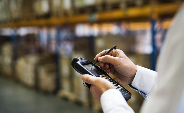 Warehouse worker managing inventory