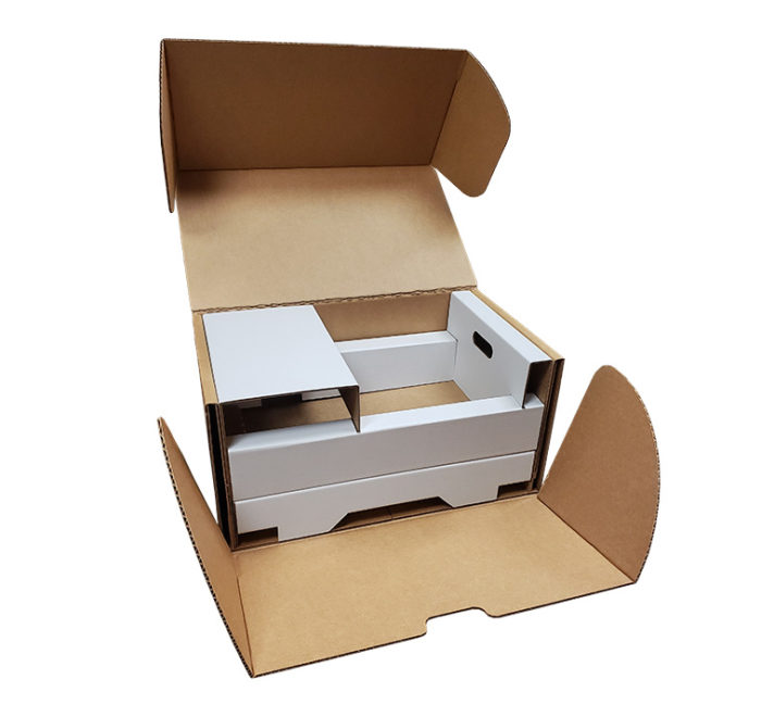 A big industrial box containing a two tiered insert designed to protect electronics