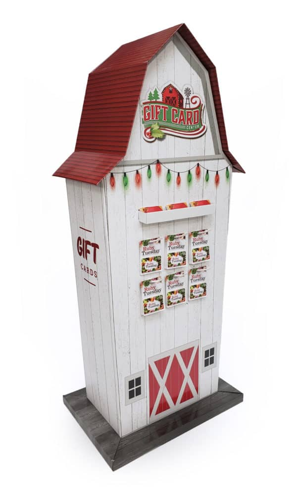Tall giftcard display design shaped like a white barn with a red roof