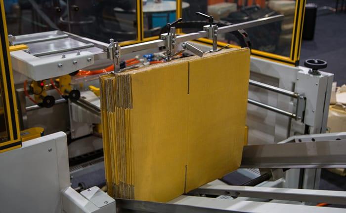 boxes going through a case erector
