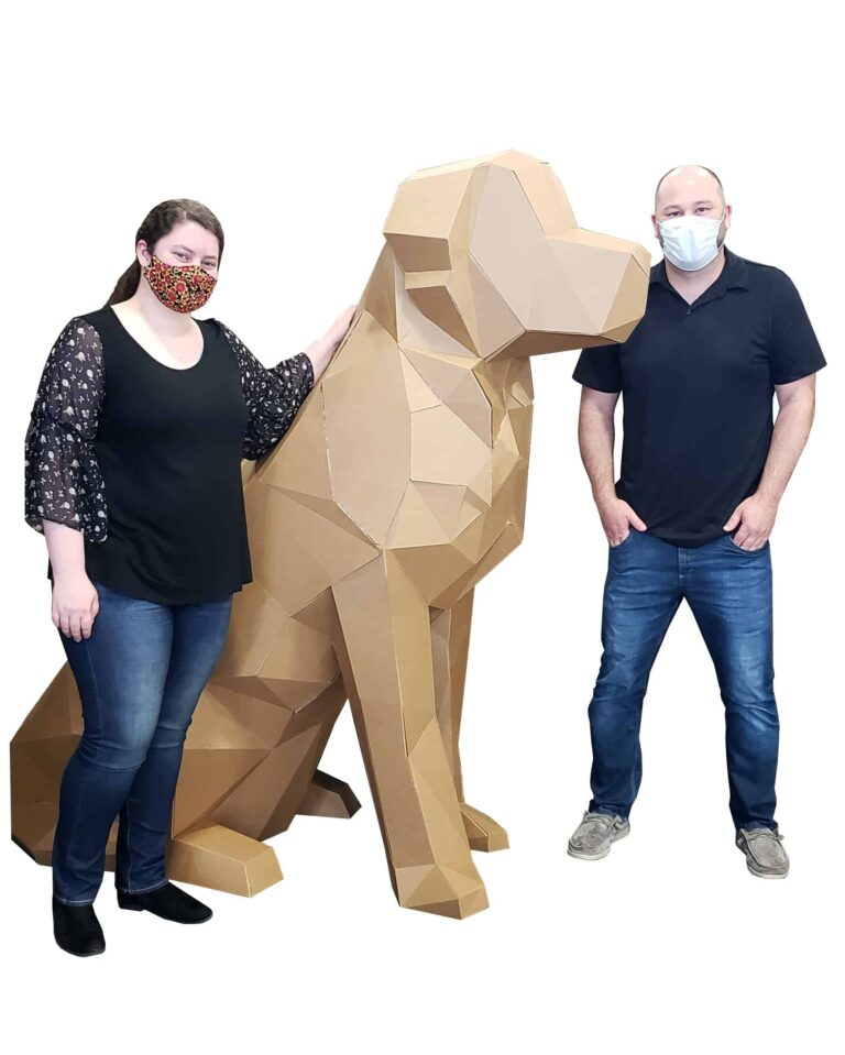 3d dog larger than a person made out of corrugated next to two people