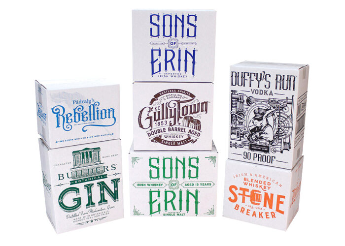 Stacks of spirits packages with colorful print on white