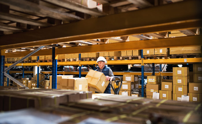 Warehousing: worker with boxes